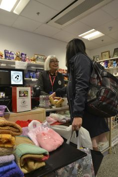 Serving customers in the Guild Shop